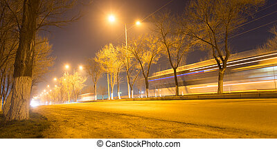 road at night with moving cars