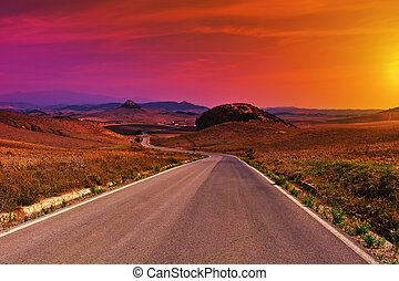 Road at Sunset - Winding Asphalt Road in the Mountains,...