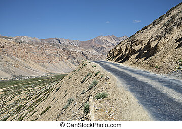 road at the side of canyon in mountains