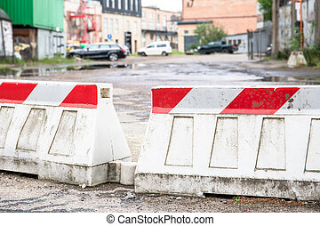 Road barriers, traffic regulation. Construction site, factory territory. Security and order