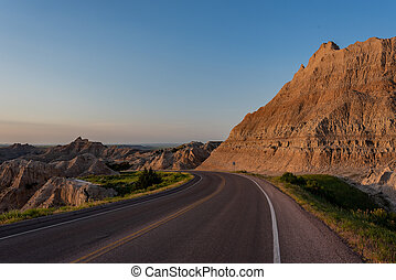 Road Bends Through Badlands Formations