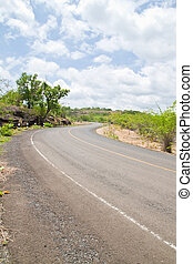Road beside Mountain and blue sky in Countryside, Pha Taem National Park, North East of Thailand