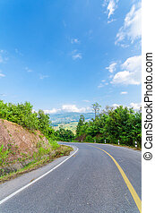 Road blue sky and clouds