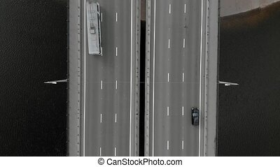 flying over a road bridge, moving cars over the bridge, aerial shooting from a copter