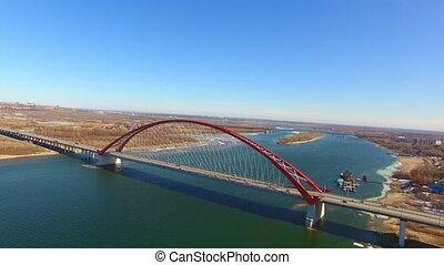 Road bridge river. Drone view of highway road and car bridge over water.