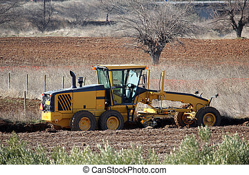 Road building machine in field - Road building machine ...