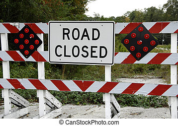 Road Closed Barricade - A barricade marking a road that has...