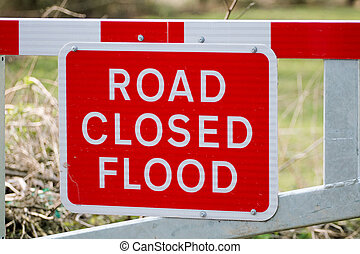 Road Closed Flood Sign on Barrier