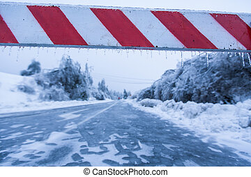 Road closed for ice with fallen trees in background