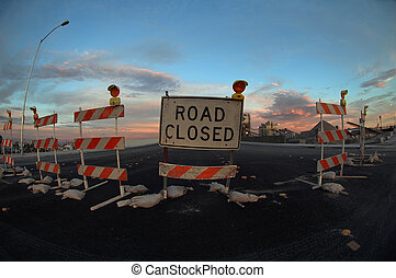 Road Closed - A closed and barricaded road in an urban...