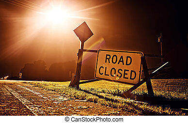 Road closed sign at night before the road construction