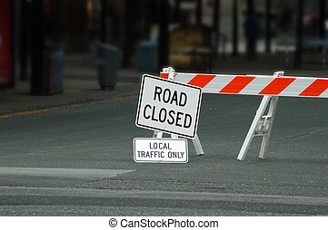 Road Closed - Signs and barricade telling motorists that the...