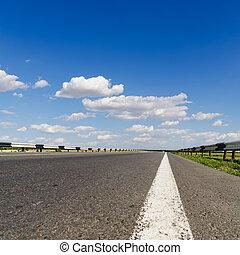 road closeup under blue sky