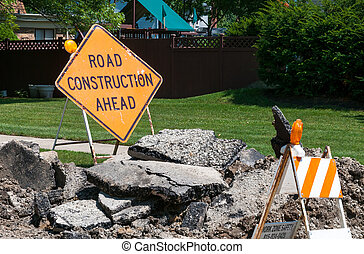 Road Construction Ahead sign on the ground