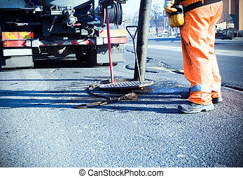 Road construction and workers - Man working on road ...
