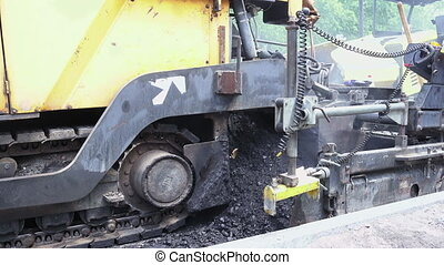 Road construction. Applying new hot asphalt. - Road...