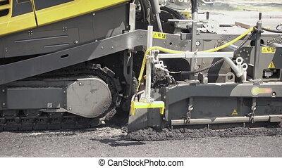 Road construction. Applying new hot asphalt. - Road...