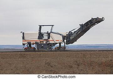 Road construction - asphalt paver machine at highway
