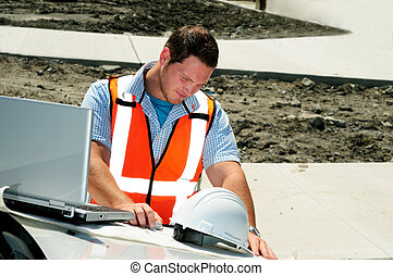 Road Construction - Road Engineer Checking Plans To A New...