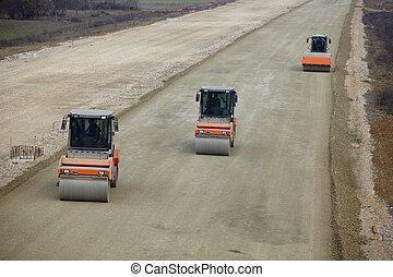 road construction - road roller leveling new asphalt on road