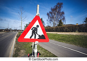 Road construction sign by a roadside