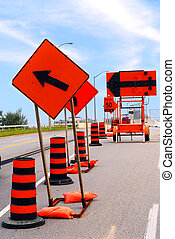 Road construction signs and cones on a city street