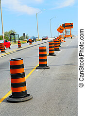 Road construction signs and cones on city street