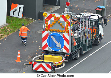 Road construction truck and workers