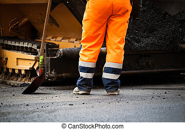 Road construction worker and shovel