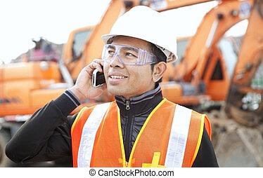 road construction worker in front of excavator - road ...