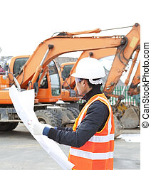 road construction worker in front of excavator - road...