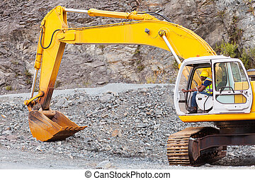 road construction worker operating excavator