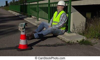 Road construction worker sleep on the bridge