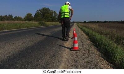 Road construction worker talk on walkie-talkie