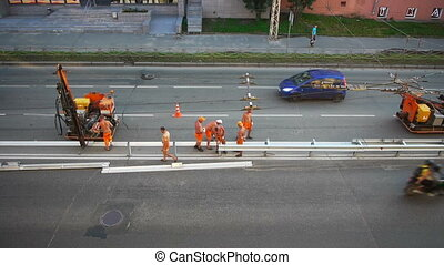 Road construction workers aerial view