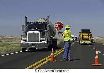 Road construction - Workers did organice the traffic at a ...