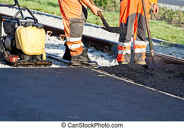 Road construction - Workers on a road construction