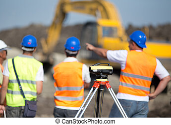 Road construction works - Theodolite on tripod at road ...