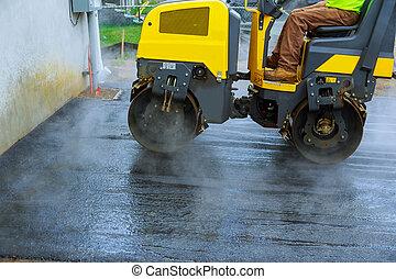Road construction works with roller compactor machine and asphalt finisher asphalt parking for the car
