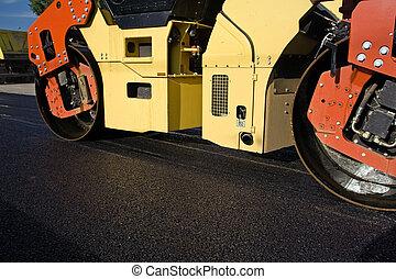 Road contruction and steamroller - Alphalt roller on road ...
