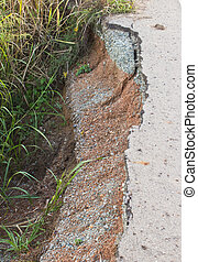 Road crack because of water erosion.