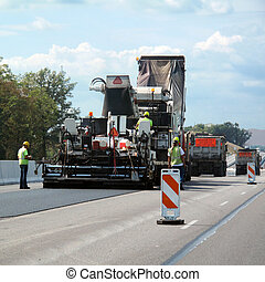 Road crew - Hard working crew repairing the highway for safe...