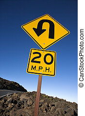 Road curve and speed limit sign. - Warning road sign...