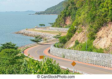 Road curved on coastline