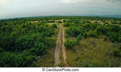 Road Dalmatian hinterland, aerial ascent shot - Copter...