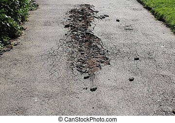 Road damage - Damaged road in Sofia, Bulgaria. Bad road ...