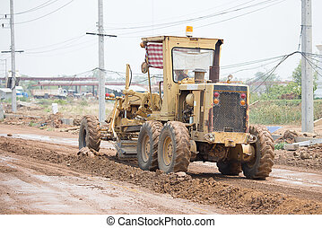 road grader at work on road construction site - Road grader ...