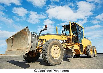 road grader bulldozer over blue sky at work outdoors