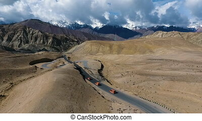 Road Heading Towards Mountains - Drone, exterior, pushing...