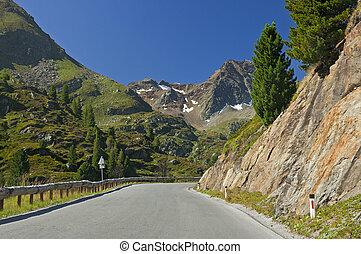 Asphalt road with curve in Alps Mountain, Kaunertal Tirol, Kaunertaler Gletscherstrasse